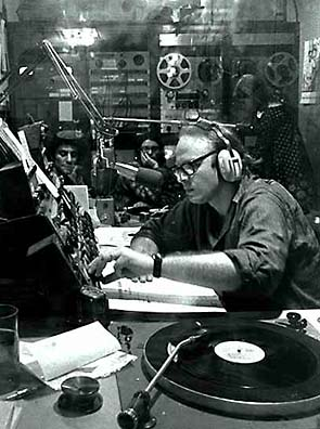 B/W Photo Bob Fass of WBAI, NYC and Abbie Hoffman in the radio control room]