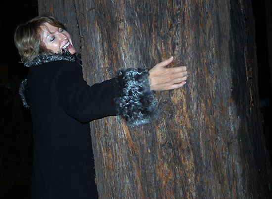 Photo: Barbara Holden Lamble hugging her friend- The Tree